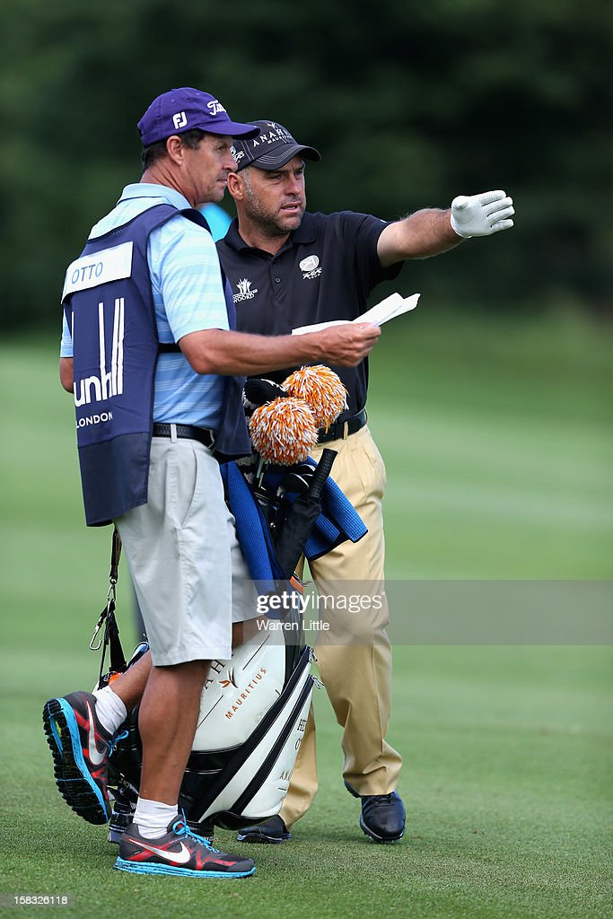 Hennie Otto of South Africa points out the line to his caddie during the first round of the Alfred Dunhill Championship at Leopard Creek Country Golf Club on December 13, 2012 in Malelane, South Africa.