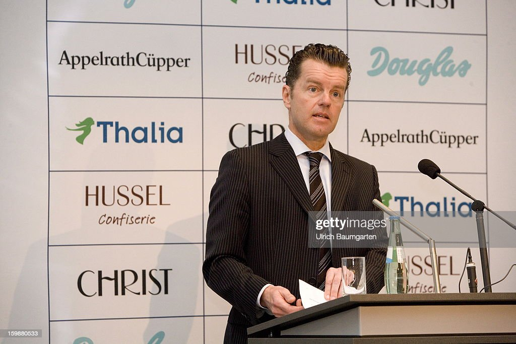 Henning Kreke, President and CEO of Douglas Holding AG attends the annual press conference at the Industry Club on January 22, 2013 in Duesseldorf, Germany. The DOUGLAS Group reports satisfactory performance in the 2011/12 fiscal year. The Group's consolidated sales revenue rose by 1.7 percent to EUR 3.44 billion. In Germany, sales revenue of the DOUGLAS Group rose by 2.7 percent to more than EUR 2.3 billion compared to the previous year. At EUR 1.1 billion, international sales lagged slightly compared to the previous year.