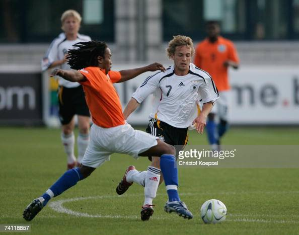 Henning Sauerbier of Germany tackles Georginio Wijnaldum of the Netherlands during the 2007 UEFA European Under 17 Championship fifth place match...