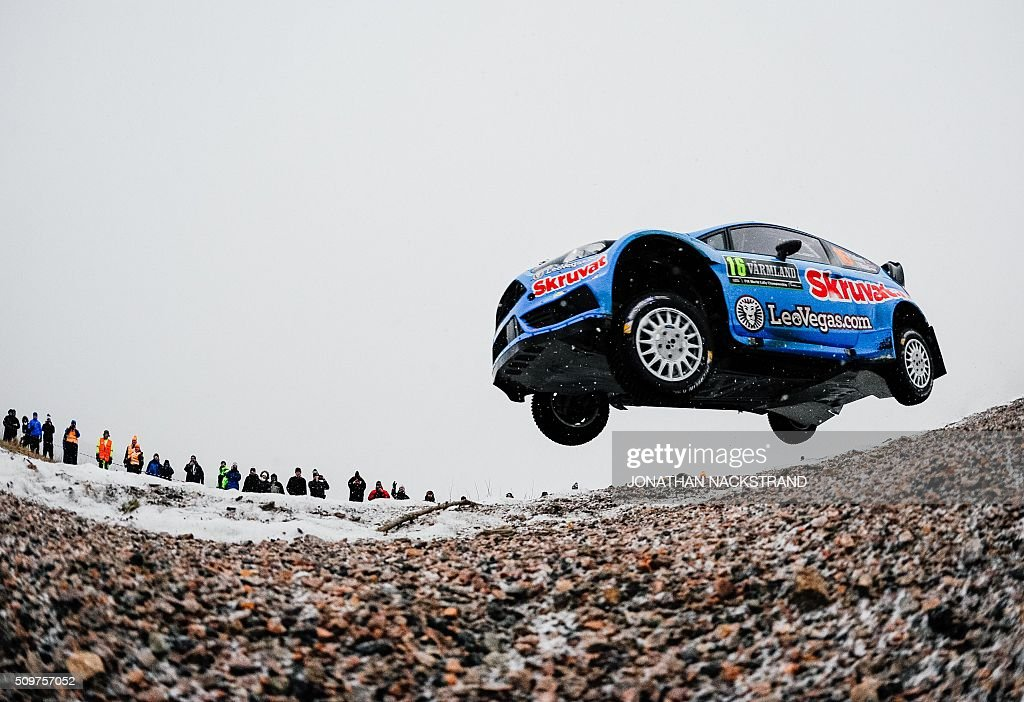 Henning Solberg of Norway and his co-driver Ilka Minor of Austria steer their Ford Fiesta during the 2nd stage of the Rally Sweden, second round of the FIA World Rally Championship on February 12, 2016 in Torsby, Sweden. / AFP / JONATHAN NACKSTRAND