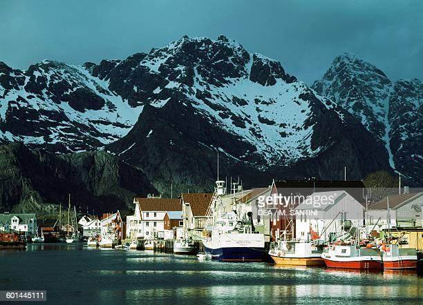 Henningsvaer fishing village with the summits of the Lofotenveggen in the background Austvagoy island Lofoten islands Nordland Norway