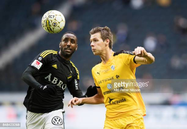 Henok Goitom of AIK and Marcus Johansson of Halmstad BK competes for the ball during the Alllsvenskan match between AIK and Halmstad BK at Friends...