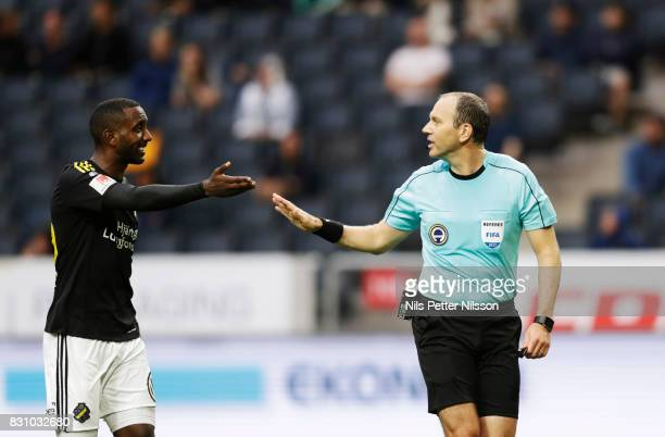 Henok Goitom of AIK in discussion with Jonas Eriksson referee during the Allsvenskan match between AIK and Athletic FC Eskilstura at Friends arena on...