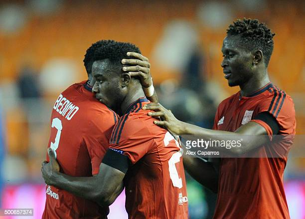 Henri Bedimo Nsame Maxwel Cornet and Mapou YangaMbiwa of Lyon celebrate after the UEFA Champions League Group H match between Valencia CF and...