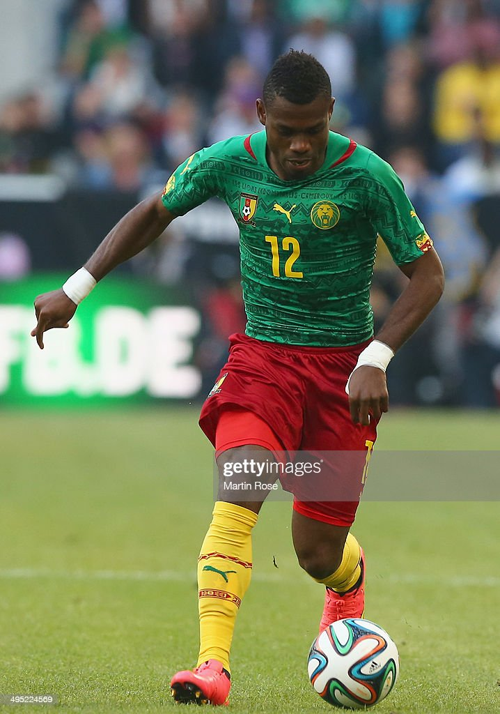 <a gi-track='captionPersonalityLinkClicked' href=/galleries/search?phrase=Henri+Bedimo&family=editorial&specificpeople=2293105 ng-click='$event.stopPropagation()'>Henri Bedimo</a> of Cameroon runs with the ball during the International Friendly Match between Germany and Cameroon at Borussia Park Stadium on June 1, 2014 in Moenchengladbach, Germany.
