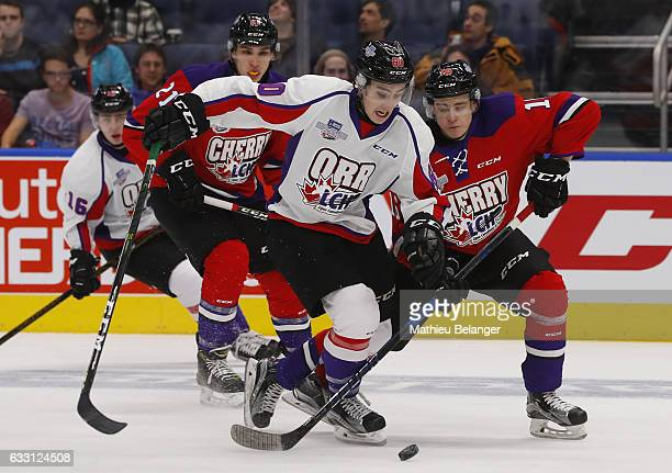 Henri Jukiharju of Team Cherry and Alex Formenton of Team Orr battle for the puck during the second period of their SherwinWilliams CHL/NHL Top...