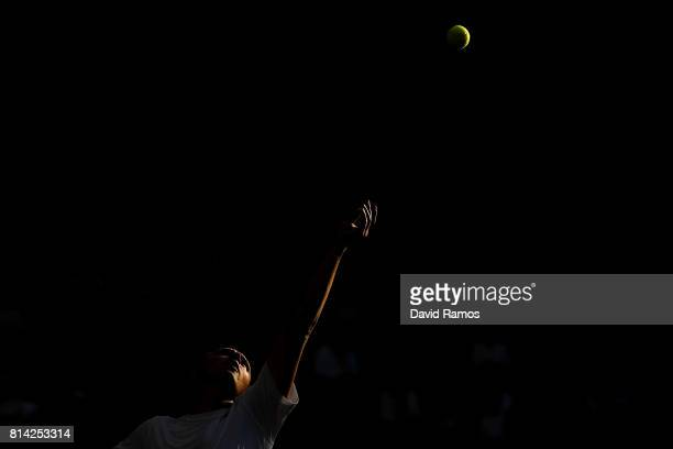 Henri Kontinen of Findland serves during the Mixed Doubles quarter final match against Rohan Bopanna of India and Gabriela Dabrowski of Canada on day...