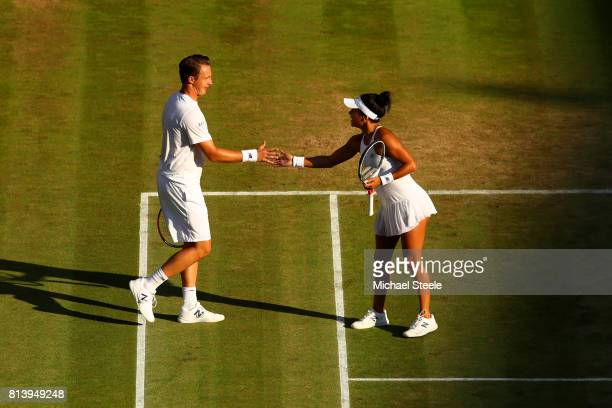 Henri Kontinen of Finland and Heather Watson of Great Britain celebrate a point in the Mixed Doubles quarter final match against Rohan Bopanna of...