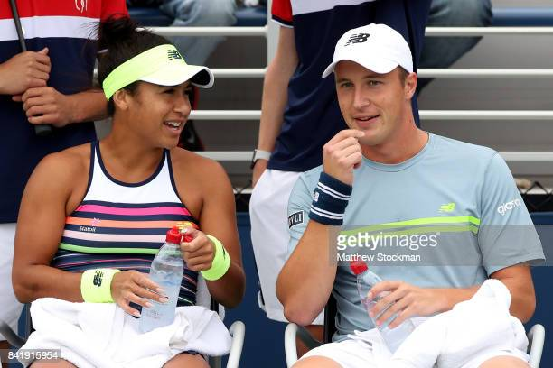 Henri Kontinen of Finland and Heather Watson of Great Britain in action against Gabriela Dabrowski of Canada and Rohan Bopanna of India and on Day...