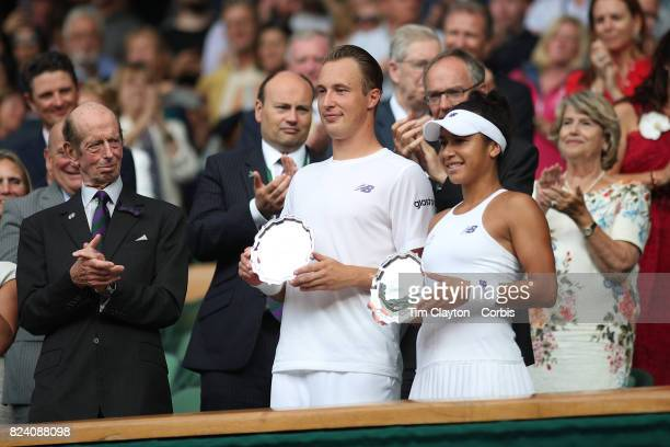 Henri Kontinen of Finland and Heather Watson of Great Britain with their runnersup trophy after the Mixed Doubles Final on Center Court during the...