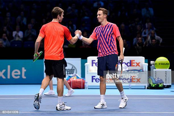 Henri Kontinen of Finland and John Peers of Australia celebrate a point during their men's doubles semifinal match against Mike Bryan of the United...