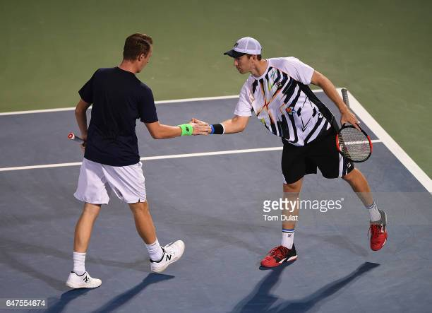 Henri Kontinen of Finland and John Peers of Australia celebrate a point during their semi final doubles match against JeanJulien Rojer of Nedherlands...