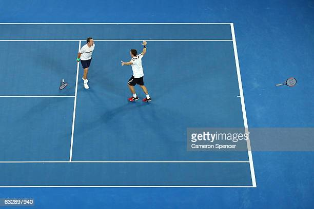Henri Kontinen of Finland and John Peers of Australia celebrate winning championship point in their Men's Doubles Final against Bob Bryan of the...