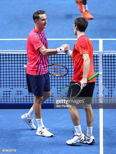 Henri Kontinen of Finland and John Peers of Australia celebrate victory during their mens singles match against Rajeev Ram of the United States and...