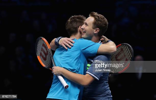 Henri Kontinen of Finland and John Peers of Australia celebrate following victory following the doubles final against Marcelo Melo of Brazil nd...