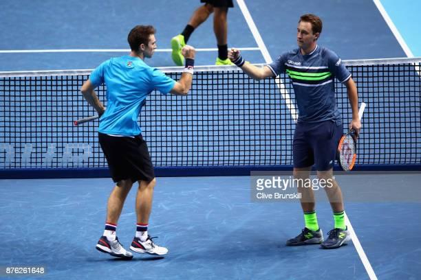 Henri Kontinen of Finland and John Peers of Australia celebrate during the doubles final against Marcelo Melo of Brazil and Lukasz Kubot of Poland...