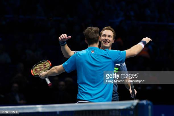 Henri Kontinen of Finland and John Peers of Australia celebrate their victory against Lukasz Kubot of Poland and Marcelo Melo of Brazil in the...