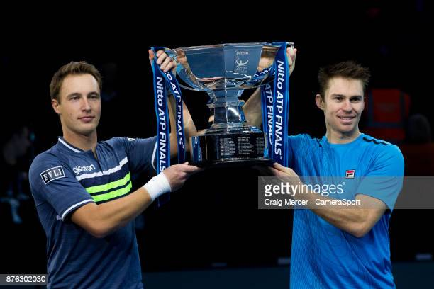 Henri Kontinen of Finland and John Peers of Australia celebrate with the winners trophy after their victory against Lukasz Kubot of Poland and...