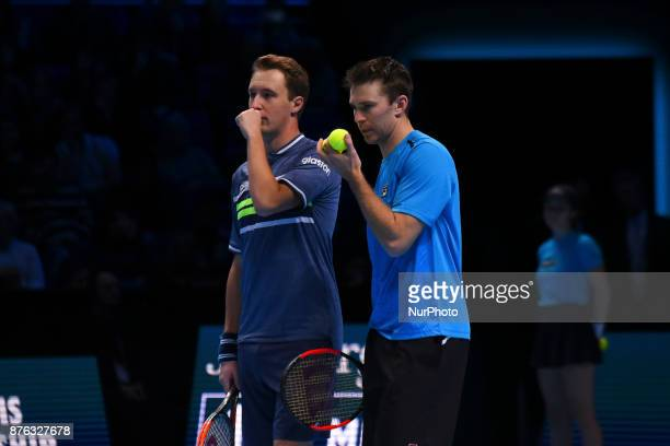 Henri Kontinen of Finland and John Peers of Australia discuss tactics against Lukasz Kubot of Poland and Marcelo Melo of Brazil in the doubles final...