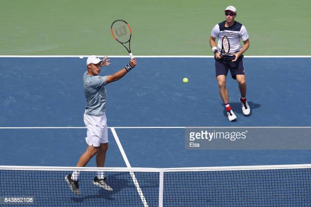 Henri Kontinen of Finland and John Peers of Australia in action against JeanJulien Rojer of the Netherlands and Horia Tecau of Romania during their...