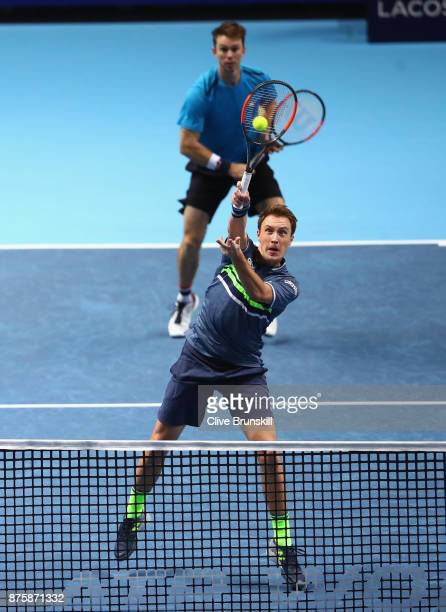 Henri Kontinen of Finland and John Peers of Australia in action against Jamie Murray of Great Britain and Bruno Soares of Brazil in their mens...