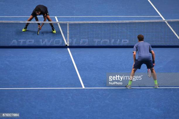 Henri Kontinen of Finland and John Peers of Australia in action against Lukasz Kubot of Poland and Marcelo Melo of Brazil in the doubles final today...