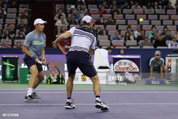 Henri Kontinen of Finland and John Peers of Australia in action duirng the Men's doubles final match against Marcelo Melo of Brazil and Lukasz Kubot...