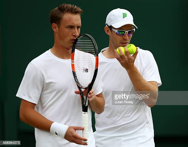 Henri Kontinen of Finland and John Peers of Australia in conversation during the Men's doubles first round match against Nicholas Monroe of The...