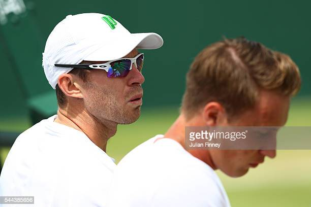 Henri Kontinen of Finland and John Peers of Australia in conversation during the Men's doubles first round match against Marcin Matkowski of Poland...
