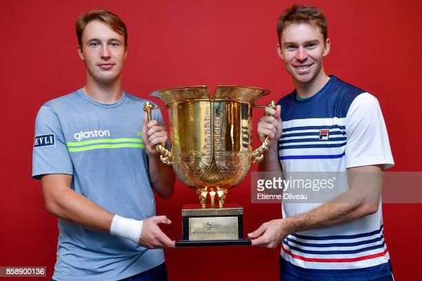 Henri Kontinen of Finland and John Peers of Australia pose for a picture holding the winners trophy after winning the Men's Doubles Final against...