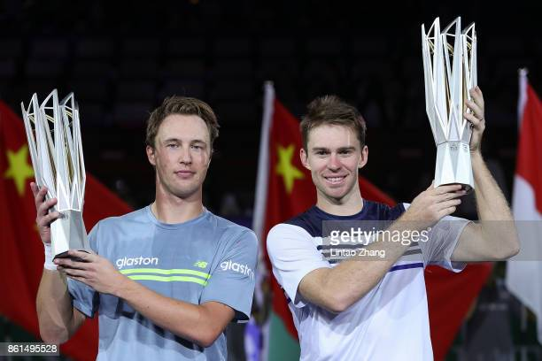 Henri Kontinen of Finland and John Peers of Australia pose with their trophy after winning the Men's doubles final match against Marcelo Melo of...