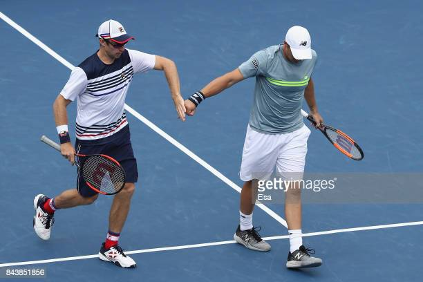 Henri Kontinen of Finland and John Peers of Australia react against JeanJulien Rojer of the Netherlands and Horia Tecau of Romania during their Men's...