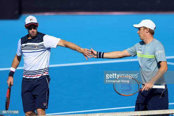 Henri Kontinen of Finland and John Peers of Australia react during their Men's Doubles Quarterfinal match against Rohan Bopanna of India and Pablo...