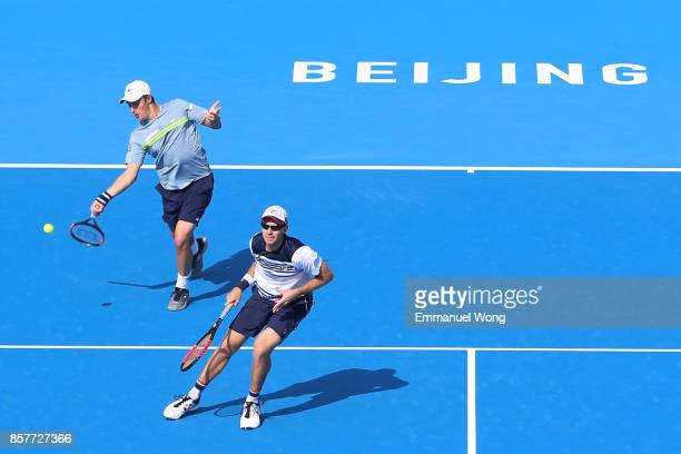 Henri Kontinen of Finland and John Peers of Australia return a shot against Rohan Bopanna of India and Pablo Cuevas of Uruguay during during their...