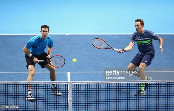 Henri Kontinen of Finland and John Peers of Australia return the ball during the doubles final against Marcelo Melo of Brazil and Lukasz Kubot of...