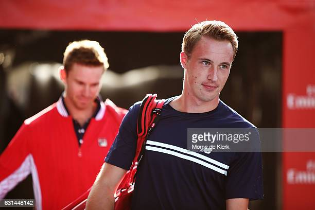 Henri Kontinen of Finland and John Peers of Australia walk onto the court to compete in a doubles match during the 2017 World Tennis Challenge at...