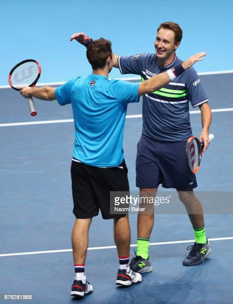 Henri Kontinen of Finland and John Peers oplays a forehand Finland celebrate victory following the doubles final against Marcelo Melo of Brazil nd...
