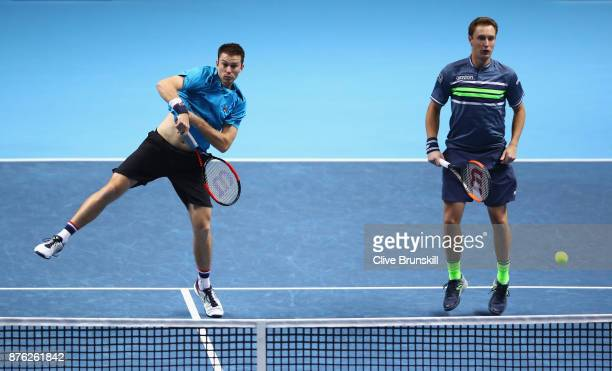 Henri Kontinen of Finland and partner John Peers of Australia return the ball during the doubles final against Marcelo Melo of Brazil and Lukasz...
