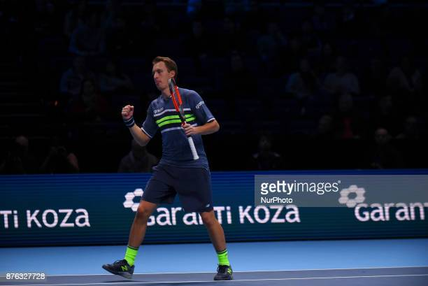 Henri Kontinen of Finland celebrates a point against Lukasz Kubot of Poland and Marcelo Melo of Brazil in the doubles final today Kontinen / Peers...
