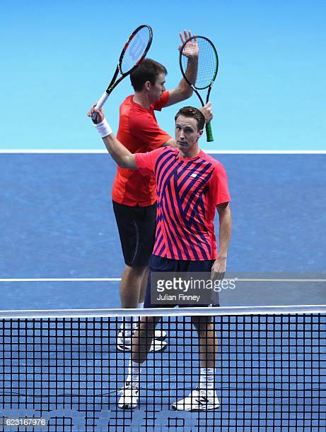 Henri Kontinen of Finland celebrates victory with his partner John Peers of Australia during the mens doubles match against Feliciano Lopez of Spain...
