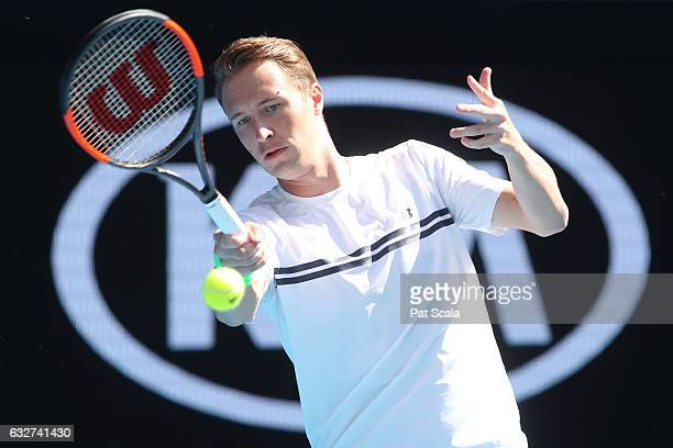 Henri Kontinen of Finland competes against Marc Polmans and Andrew Whittington of Australia in his doubles semifinal match on day 11 of the 2017...