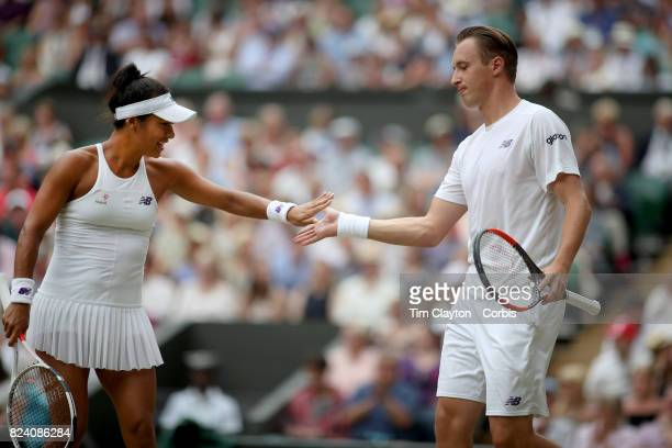 Henri Kontinen of Finland in action with Heather Watson of Great Britain during the Mixed Doubles Final on Center Court during the Wimbledon Lawn...