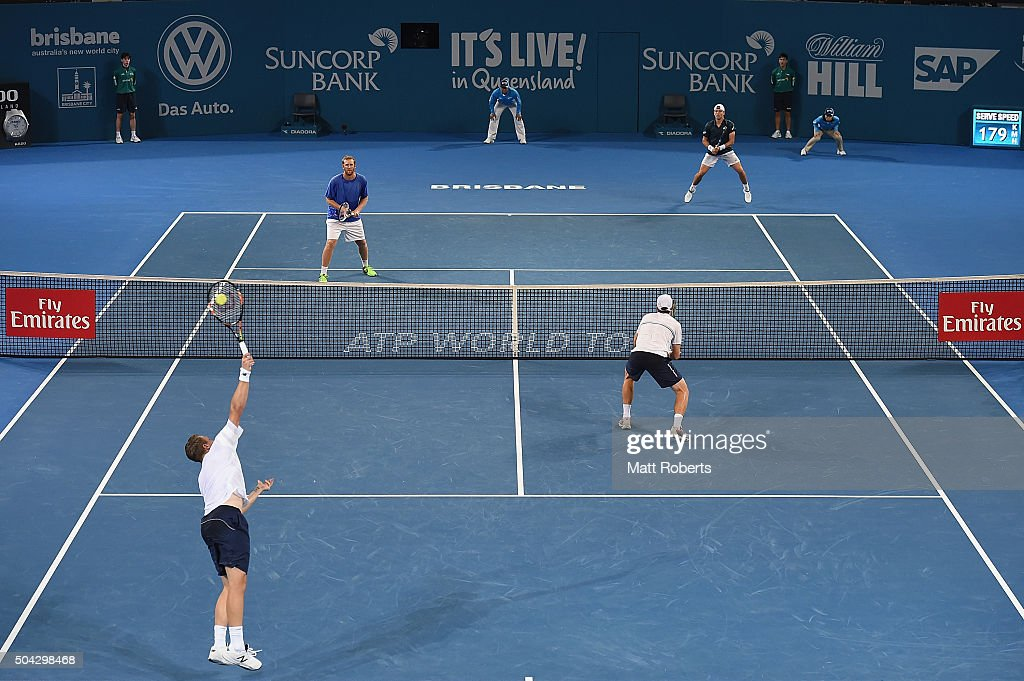 Henri Kontinen of Finland serves in the Mens Doubles Final partnered with <a gi-track='captionPersonalityLinkClicked' href=/galleries/search?phrase=John+Peers&family=editorial&specificpeople=9486129 ng-click='$event.stopPropagation()'>John Peers</a> of Australia against <a gi-track='captionPersonalityLinkClicked' href=/galleries/search?phrase=Chris+Guccione+-+Tennisspieler&family=editorial&specificpeople=217596 ng-click='$event.stopPropagation()'>Chris Guccione</a> of Australia and <a gi-track='captionPersonalityLinkClicked' href=/galleries/search?phrase=James+Duckworth&family=editorial&specificpeople=2573096 ng-click='$event.stopPropagation()'>James Duckworth</a> of Australia during day eight of the 2016 Brisbane International at Pat Rafter Arena on January 10, 2016 in Brisbane, Australia.
