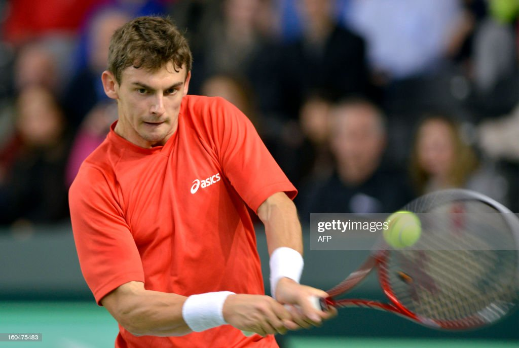 Henri Laaksonen of Switzerland returns a ball on February 1, 2013 to Tomas Berdych of the Czech Republic during the Davis Cup World Group first round match between Switzerland and the Czech Republic in Geneva.