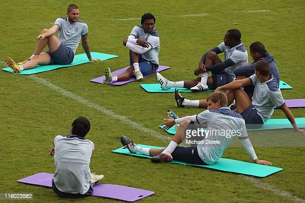 Henri Lansbury and Daniel Sturridge go through stretching exercises ahead of their UEFA European Under21 Championship Group B match against Ukraine...