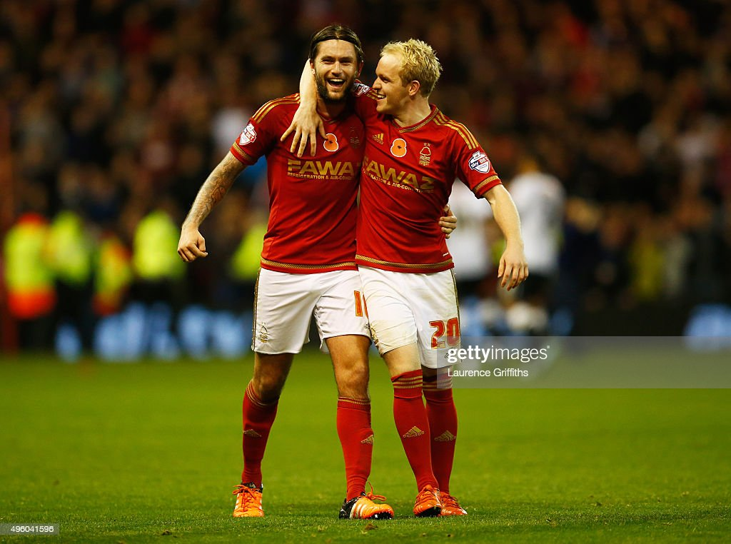 Henri Lansbury and Jonathan Williams of Nottingham Forest celebrate victory after the Sky Bet Championship match between Nottingham Forest and Derby County at City Ground on November 6, 2015 in Nottingham, England.