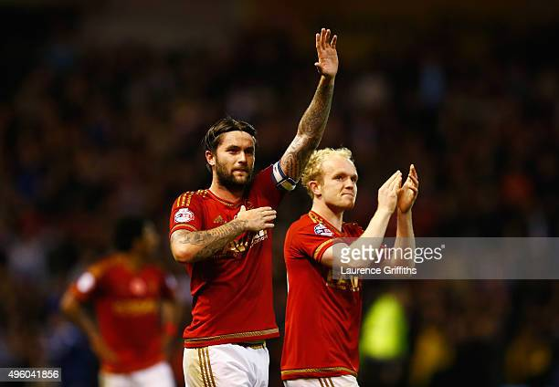 Henri Lansbury and Jonathan Williams of Nottingham Forest celebrate victory after the Sky Bet Championship match between Nottingham Forest and Derby...