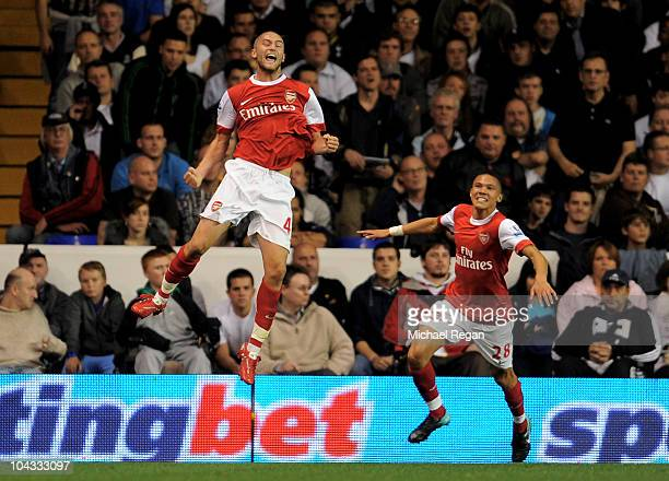 Henri Lansbury of Arsenal celebrates after scoring the opening goal during the Carling Cup third round match between Tottenham Hotspur and Arsenal at...