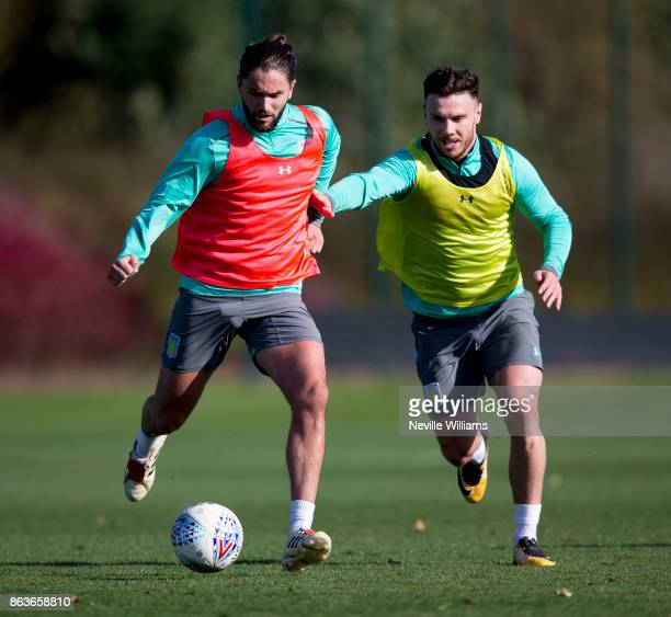 Henri Lansbury of Aston Villa in action with team mate Scott Hogan during a training session at the club's training ground at Bodymoor Heath on...