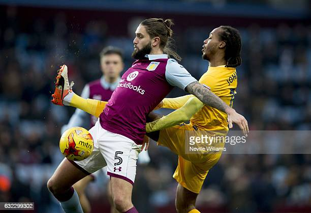 Henri Lansbury of Aston Villa is challenged by Daniel Johnson of Preston North End during the Sky Bet Championship match between Aston Villa and...